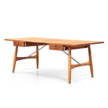175. HANS J WEGNER, A Hans J. Wegner teak and oak 'JH 571' desk executed by Johannes Hansen, Denmark 1950-60's.