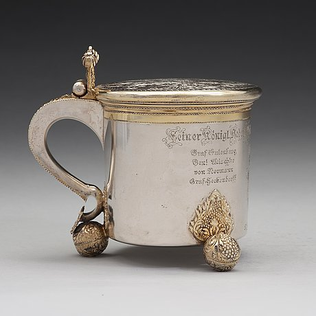 A swedish early 18th century parcel-gilt silver tankard, mark of sven wallman, gothenburg 1704.