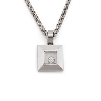 "A Chopard ""Happy diamonds"" brilliant cut diamond pendant. Carat weight of diamond 0.05ct. Serial number 3102422."