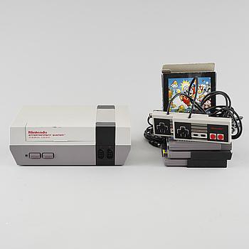 NINTENDO, NES 8-bits konsol, 2 kontroller, samt tre spel, 1980-tal.