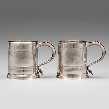 124. A pair of English early 18th century silver muggs, mark of John Cory, London 1704.