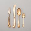A set of english early 20th century gold and silver-gilt 64 piece dessert cutlery, marked robert dicker, london 1902-03.