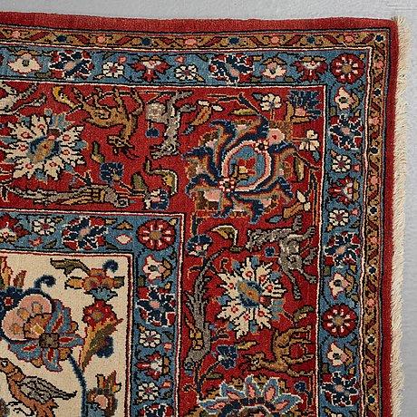 A carpet, a semi-antique qum, ca 335 x 217 cm.