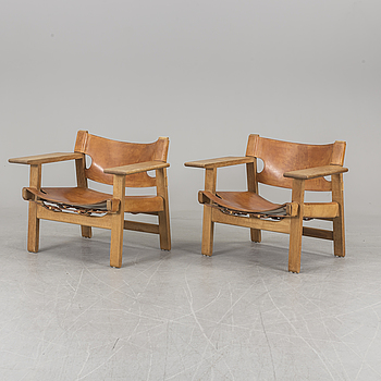 A pair of Børge Mogensen oak and leather 'Spanish chairs', Fredericia, Denmark.