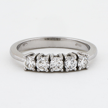 A brilliant cut diamond ring.