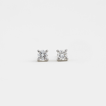 A pair of brilliant cut diamonds earrings.