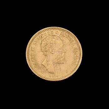 MYNT, guld, 10 kr, Oscar II, 1874 Vikt ca 4 gram.