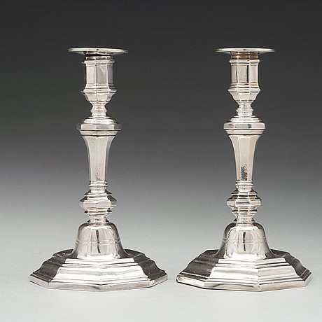 A pair of french 18th century silver candlesticks, unidentified makers mark.