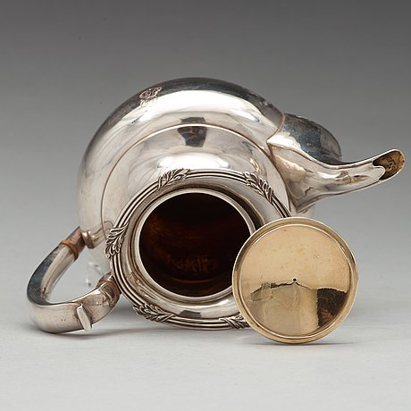 A russian 19th century parcel-gilt silver tea- and coffee-set, unidentified makers mark fk, st petersburg 1837.