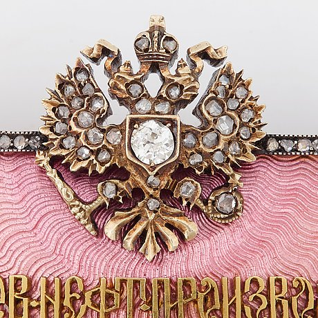 A fabergÉ gold, enamel and diamond nobel brooch.