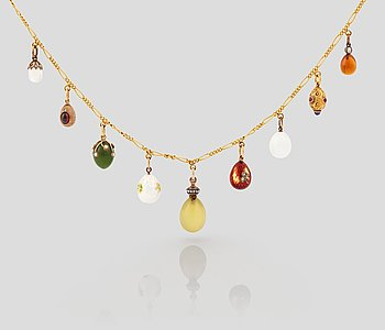 229. A FABERGÉ  GOLD Chain Necklace WITH 9 GOLD, ENAMEL ETC MINIATURE EASTER EGG PENDANTS, S.T PETERSBURG 1899-1908.