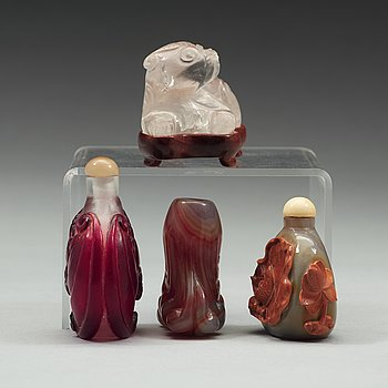 597. A group of three snuff bottles and a rock chrystal figure, 20th century.