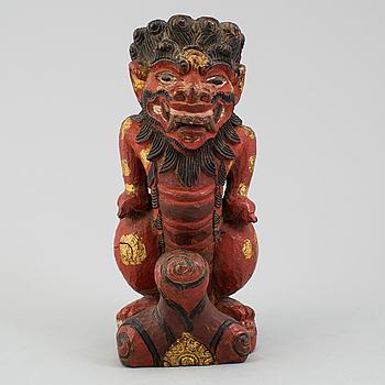 A wooden sculpture of a deity, India, circa 1900.