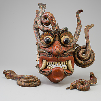 A large wooden dance mask, South-East Asia, early 20th Century.