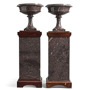 16. A pair of Swedish porpyry vases on wooden bases, Älvdalen, first half of the 19th century.