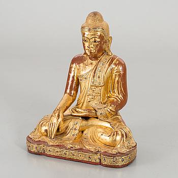 A Burmese gilded wooden Buddha, around 1900.