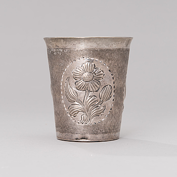 A 18th century unmarked silver beaker.