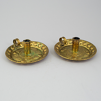 A pair of brass baroque style candlesticks.