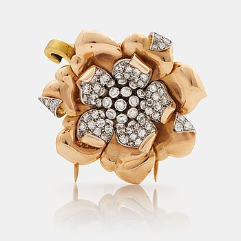 908. A 1940/50s brooch by Boucheron, in the shape of a flower, set with brilliant cut diamonds.