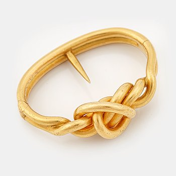 226. A Fabergé gold scarf ring, workmaster August Hollming , St Petersburg, 1896-1908.