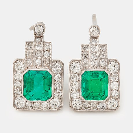 A pair of 1940/50's emerald cut emeralds and brilliant- and single cut diamond earrings.