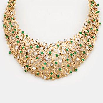 811. A emerald and brilliant cut diamond necklace by Gilbert Albert, Geneve, Zürich.