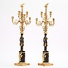 A pair of empire early 19th century six light candelabra