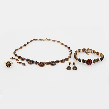 A garnet necklace, bracelet, pair of earrings and ring.