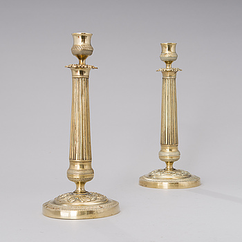 A pair of Empire bronze candlesticks from the first half of the 19th century.
