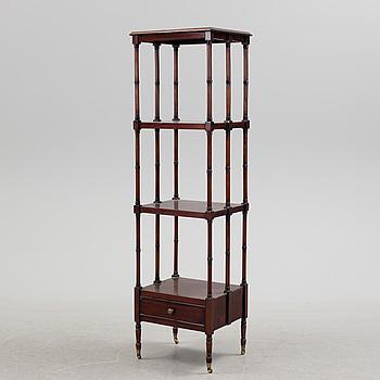 A Mahogany shelf, ca 1900.
