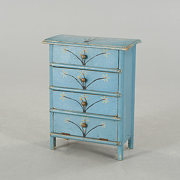 A children's chest of drawers, dated 1937.
