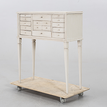 A CHEST OF DRAWERS.