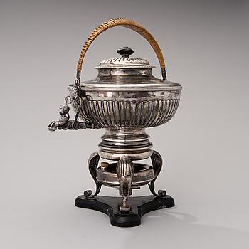 A silver teapot. Austria-Hungary, ca 1850; and a silver burner, Möllenborg-Feron, Stockholm 1873.