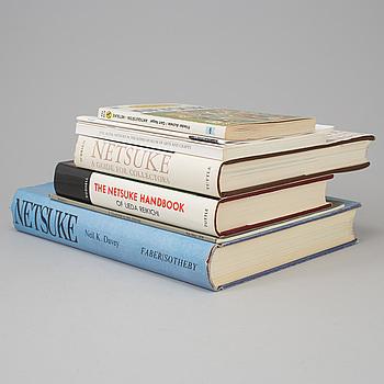 A set of five books about Netsuke, and a catalog.