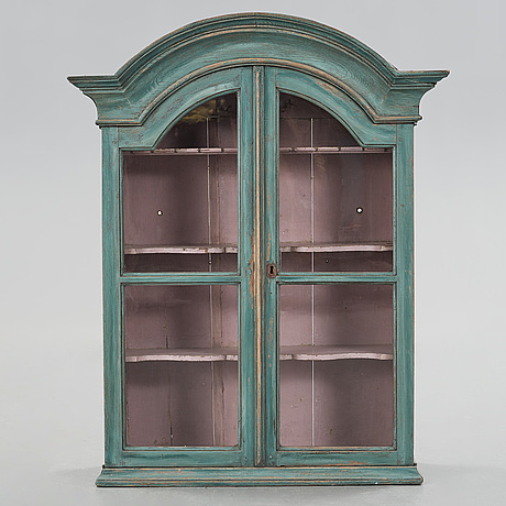 A folklore wall cabinet from ljusdal hälsingland in the 18th-/19th century.