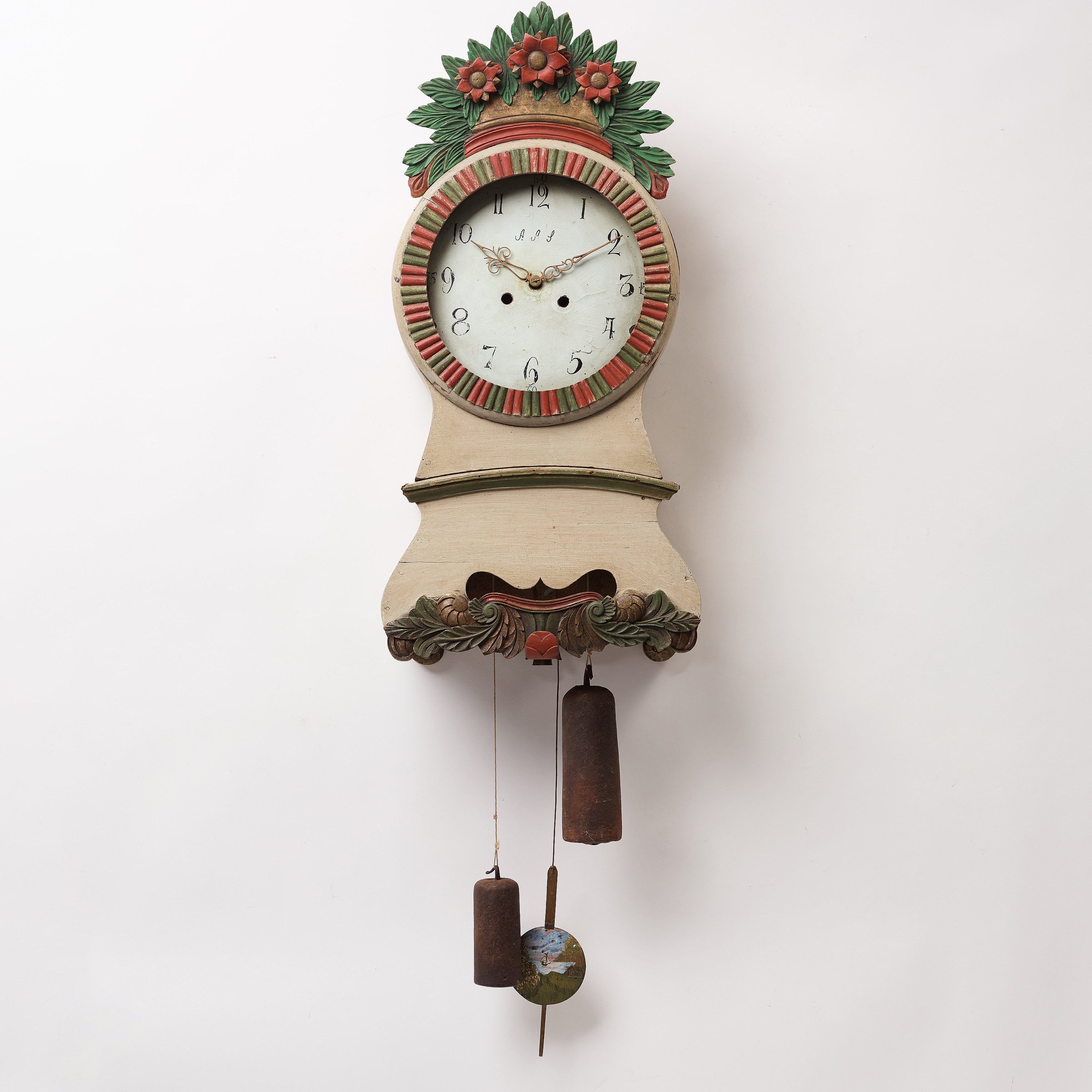 a painted wall pendulum clock from Ångermanland in the first