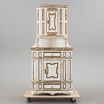 A Baroque style corner cabinet, 19th Century.