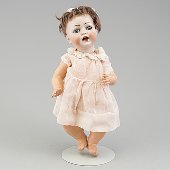 a porcelain doll from the early 20th century.