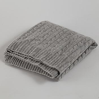A cashmere blanket by Ralph Lauren.