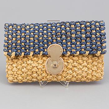 A  bast clutch by Ralph Lauren.