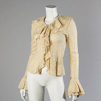 A wool/alpaca jacket by Ralph Lauren and two blouses.