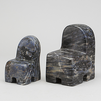 POUL ISBAK, a set of two signed and dated sculptures.