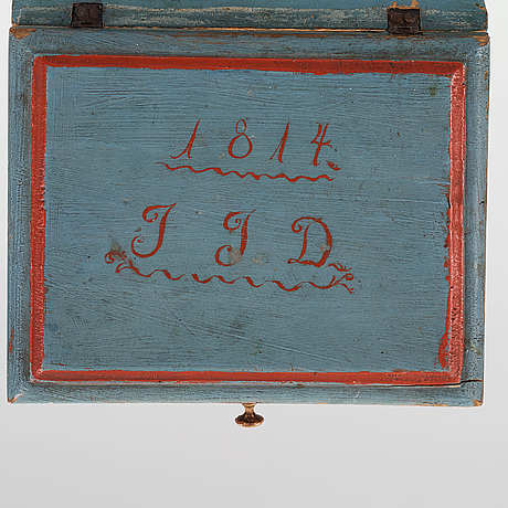 A wooden box marked jjd 1814.