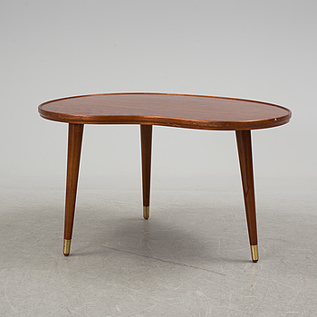 a mahogany coffee table from the middle of the 20th century.