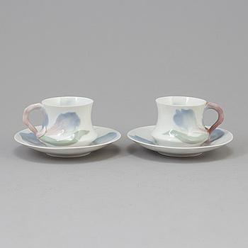 "ALF WALLANDER, A pair of Alf Wallander ""Iris"" porcelain coffee cups from Rörstrand, early 20th century."