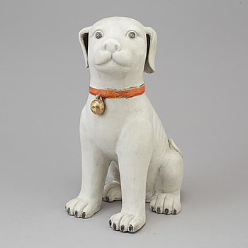 A chinese porcelain figure of a dog, after a 18th century model. China, 20th Century.