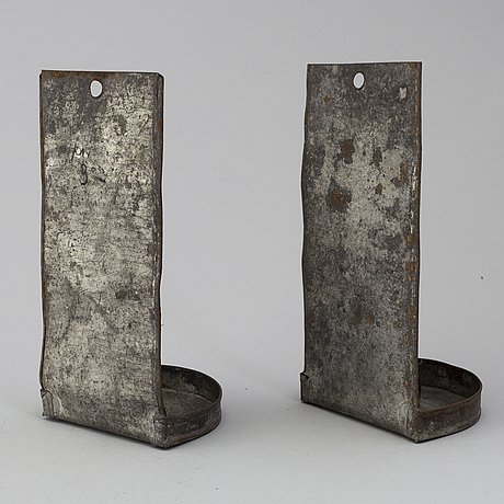 A pair of metal wall sconces, 19th century