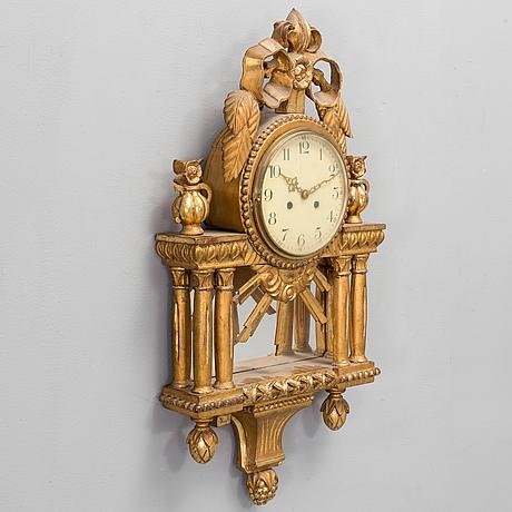 A wall clock, gustavian style, 20th century.