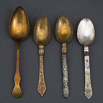 Four 18th century brass and iron spoons.