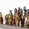 Marie-louise idestam blomberg, a pewter and gilt pewter chess set with board by svenskt tenn, stockholm 1946.